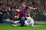 Kevin De Bruyne of Manchester City is challenged by Eric Dier of Tottenham Hotspur during the premier league match at the Wembley Stadium, London. Picture date 14th April 2018. Picture credit should read: Robin Parker/Sportimage