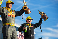 Feb 24, 2019; Chandler, AZ, USA; NHRA top fuel driver Billy Torrence (right) celebrates alongside funny car driver Matt Hagan after winning the Arizona Nationals at Wild Horse Pass Motorsports Park. Mandatory Credit: Mark J. Rebilas-USA TODAY Sports
