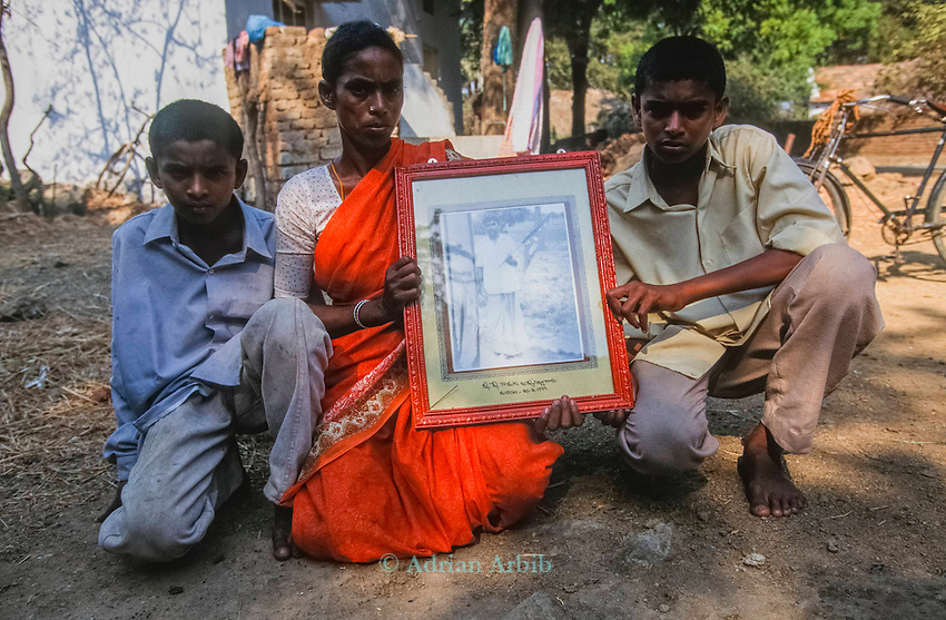 Pestidcide used by a farmer to commit suicide,  Warangal, India.   Many indian farmers prefer to kill themselves rather than to  face up to the shame of debt - incurred  by  borrowing money to  buy  GM seeds which subsequently  failed to  grow.
