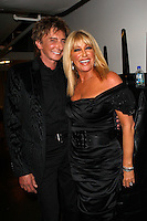 Barry Manilow and Suzanne Somers.Premier U.S.A. Arts High 25th Anniversary Celebration at the Ahmanson Theater in Los Angeles, California.17 April 2010.Photo by Nina Prommer/Milestone Photo
