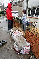 Pictured: Joanne Mardon (R) receives a food bank delivery outside her flood affected  house in Wordsworth Gardens in the Rhydyfelin area of Pontypridd. Wednesday 04 March 2020<br /> Re: Revisiting the flood affected areas in Pontypridd, Wales, UK.