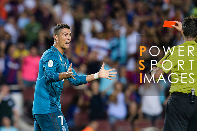 Cristiano Ronaldo of Real Madrid (L) who gestures after gets a red card from Fifa Referee Ricardo de Burgos Bergoetxea (R) during the Supercopa de Espana Final 1st Leg match between FC Barcelona and Real Madrid at Camp Nou on August 13, 2017 in Barcelona, Spain. Photo by Marcio Rodrigo Machado / Power Sport Images