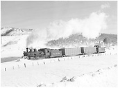 Fireman's side view of K-27 #464 plowing snow with a consist of 2 fish belly flats with covered loads and a long RGS caboose between Hepserus and Cima.<br /> RGS  Hesperus - Cima, CO  Taken by Richardson, Robert W. - 12/17/1951