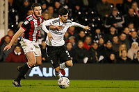 Jack O'Connell of Sheffield United and Rui Fonte of Fulham FC battle for the ball during the Sky Bet Championship match between Fulham and Sheff United at Craven Cottage, London, England on 6 March 2018. Photo by Carlton Myrie.