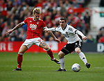 Jason Cummings of Nottingham Forest and John Fleck of Sheffield Utd during the Championship match at the City Ground Stadium, Nottingham. Picture date 30th September 2017. Picture credit should read: Simon Bellis/Sportimage