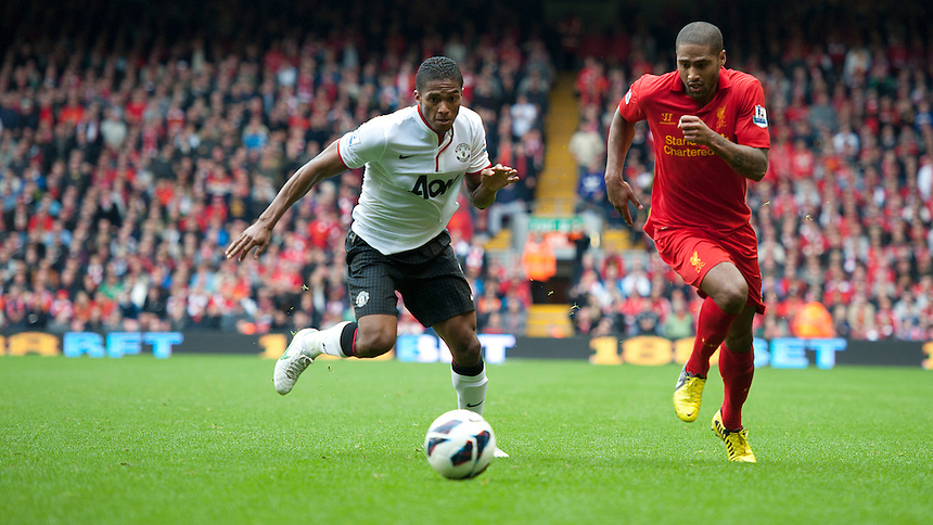 Liverpool's Glen Johnson and Manchester United's Luis Antonio Valencia ..Football - Barclays Premiership - Liverpool v Manchester United - Sunday 23rd September 2012 - Anfield - Liverpool..