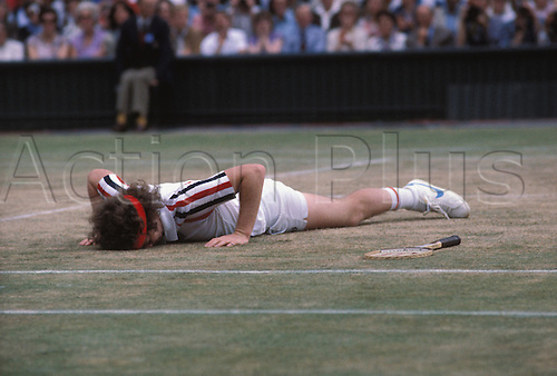July 1980: American player JOHN McENROE lies on the ground in anguish during his Wimbledon Men's Singles Final defeat to Borg Photo: Leo Mason/Action Plus...tennis loser losing disappointment lose man 8007