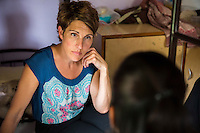 Tamsin Greig, an actress from the United Kingdom, speaks with Anisha (name changed), aged 19, about her past experiences as they sit in Nirmal Bhavan, a rehabilitation home for trafficked and rescued girls run by Tearfund partner NGO Oasis India, in Mumbai, Maharashtra, India on 20 February 2014. Brought to Mumbai by a family friend, Anisha was forced to dance for customers at a Mujura, a sexually provocative men-only party. She was badly beaten when she refused to attend customers, and locked in a cupboard. She managed to flee and go to the Police, where her courageous testimony enabled the authorities to prosecute those responsible. Photo by Suzanne Lee/Tearfund