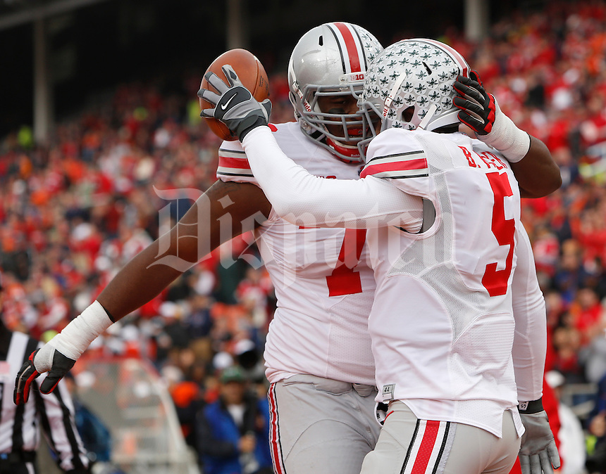 Ohio State Buckeyes offensive linesman Marcus Hall (79) congratulates Ohio State Buckeyes quarterback Braxton Miller (5) on scoring a touchdown during Saturday's NCAA Division I football game against Illinois at Memorial Stadium in Champaign, Il., on November 16, 2013. (Barbara J. Perenic/The Columbus Dispatch)