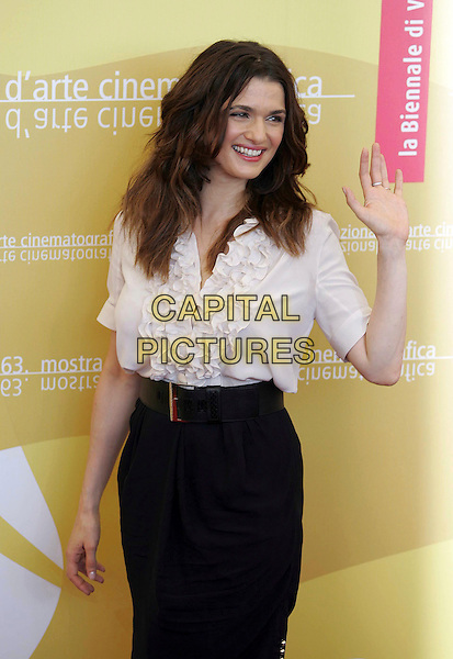 "RACHEL WEISZ.Photocall for ""The Fountain"" at the 63rd Venice International Film Festival, Venice, Italy..September 4th, 2006.Ref: OME.half length white ruffles top blouse black skirt.www.capitalpictures.com.sales@capitalpictures.com.©Omega/Capital Pictures."
