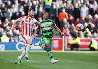 Stoke City's Phil Bardsley and Swansea City's Wayne Routledge chase a ball during the Barclays Premier League match between Stoke City and Swansea City played at Britannia Stadium, Stoke on April 2nd 2016