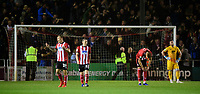 Lincoln City's Harry Anderson, left, rallies the crowd after Everton's Alex Iwobi scored his sides third goal of the game<br /> <br /> Photographer Chris Vaughan/CameraSport<br /> <br /> The Carabao Cup Second Round - Lincoln City v Everton - Wednesday 28th August 2019 - Sincil Bank - Lincoln<br />  <br /> World Copyright © 2019 CameraSport. All rights reserved. 43 Linden Ave. Countesthorpe. Leicester. England. LE8 5PG - Tel: +44 (0) 116 277 4147 - admin@camerasport.com - www.camerasport.com