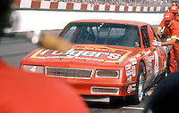 Joe Ruttman's Chevrolet Monte Carlo gets a pusch on pit road during the Southern 500 at Darlington Raceway in Darlington SC on September 1, 1985. (Photo by Brian Cleary/www.bcpix.com)