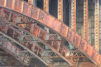 The stone and steel girder arch supports of the Longfellow Bridge, which spans the Charles River from Cambridge to Beacon Hill in Boston, Massachusetts