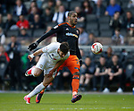 George Baldock of MK Dons in action with Leon Clarke of Sheffield Utd during the English League One match at  Stadium MK, Milton Keynes. Picture date: April 22nd 2017. Pic credit should read: Simon Bellis/Sportimage