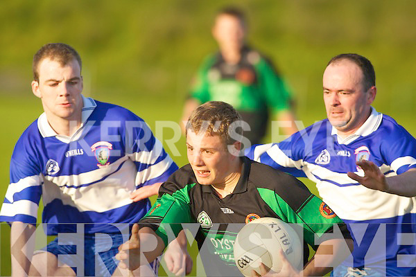 Cyprian Jouvre Curchill under pressure from Daniel Lane and Stephen Mulvhill Ballylongford in their county league clash at Tralee IT on Saturday eveningCurchill v Ballylongford County League