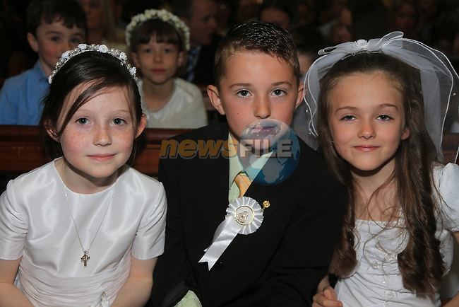 Eve Carraig, Adrian Javanagh and Orla O'Toole.students from Le Cheile ETNS making there first communion in ST Mary's Chruch..Picture:  www.newsfile.ie ..