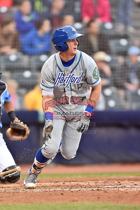 Hartford Yard Goats third baseman Ryan McMahon (13) runs to first during a game against the Richmond Flying Squirrels at The Diamond on April 30, 2016 in Richmond, Virginia. The Yard Goats defeated the Flying Squirrels 5-1. (Tony Farlow/Four Seam Images)