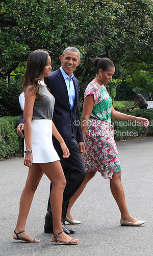 United States President Barack Obama, center, first lady Michelle Obama, right, and Malia Obama, left, leave the White House en route to Martha's Vineyard for a two week vacation on August 9, 2014.  <br /> Credit: Dennis Brack / Pool via CNP