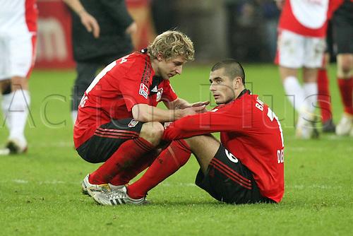 Bayer Leverkusen Disappointed Stefan KieBling Leverkusen left Eren Derdiyok Leverkusen. Photo: Imago/Actionplus. Editorial Use UK.