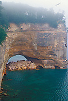 The Grand Portal rock formation of Pictured Rocks National Lakeshore near Munising, Mich. in the fog.