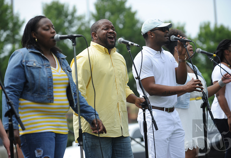 NWA Democrat-Gazette/ANDY SHUPE<br /> Singers from the group Reginald James and the Messengers perform Saturday, June 17, 2017, during the Juneteenth celebration in The Gardens on the University of Arkansas campus in Fayetteville. Juneteenth marks the anniversary of the emancipation of slaves in the United States.