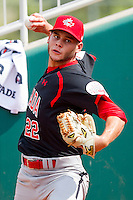 Nick Bucci #22 of the Canadian World Cup/Pan Am Team warms up in the bullpen prior to the game against Team USA at the USA Baseball National Training Center on September 28, 2011 in Cary, North Carolina.  (Brian Westerholt / Four Seam Images)