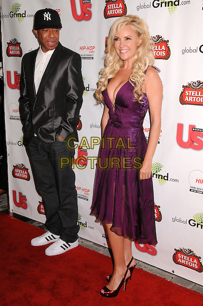 RUSSELL SIMMONS & BRIDGET MARQUARDT.2009 Grammy Awards Post Party at a Private Residence, Beverly Hills, California, USA..February 8th, 2009.full length jeans denim black shiny jacket purple dress plunging neckline cleavage sheer funny staring.CAP/ADM/BP.©Byron Purvis/AdMedia/Capital Pictures.