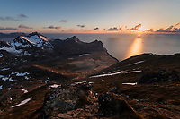 Evening sunset over Myrland from Slettind mountain peak, Flakstadøy, Lofoten Islands, Norway