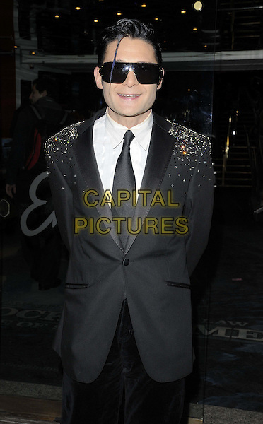 Corey Feldman.The 'Star Wars Episode 1: The Phantom Menace 3Dl' special screening, Empire cinema, Leicester Square, London, England..February 8th, 2012.half length black suit tie white shirt sunglasses shades beads beaded .CAP/CAN.©Can Nguyen/Capital Pictures.