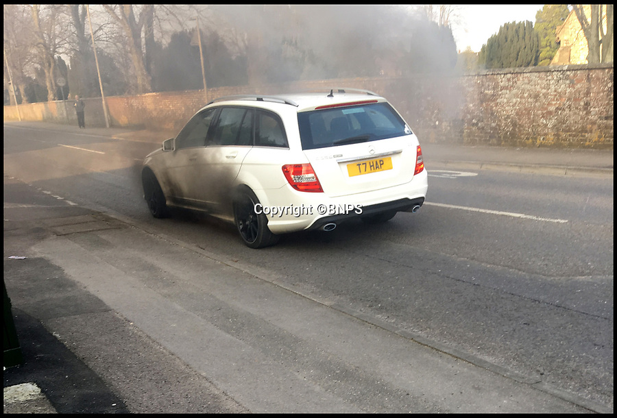 BNPS.co.uk (01202 558833)<br /> Pic: JohnPearce/BNPS<br /> <br /> BA pilot makes emergency evacuation - from his Mercedes.<br /> <br /> A British Airways pilot had a lucky escape when his Mercedes car suddenly burst into flames as he drove home.<br /> <br /> John Pearce was oblivious to the fire that erupted underneath his white Mercedes C350 AMG estate car and ignored a motorist who tried to warn him by flashing his lights.<br /> <br /> It was only when a police officer pulled in behind Mr Pearce's blazing motor and also flashed him that he stopped.<br /> <br /> The officer got out and told Mr Pearce that his car was on fire which prompted the pilot to jump out of the diesel estate.