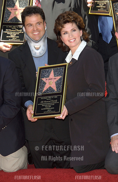 Singers DONNY OSMOND & MARIE OSMOND on Hollywood Boulevard where The OSMONDS FAMILY were honored with the 2,232nd star on the Hollywood Walk of Fame..Aug 7, 2003