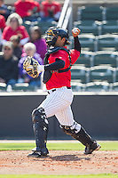 Kannapolis Intimidators catcher Omar Narvaez (10) makes a throw to third base following a strike out during the game against the Hickory Crawdads at CMC-Northeast Stadium on April 9, 2014 in Kannapolis, North Carolina.  The Intimidators defeated the Crawdads 1-0.  (Brian Westerholt/Four Seam Images)