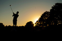 A golfer tees off at sunset on Mississippi State University's Golf Course. Located at 14279 Old Highway 182 in Starkville, the course is listed &quot;among the top 30 collegiate golf courses.&quot; Call (662) 325-3028 or click here to reserve your tee time today!<br />