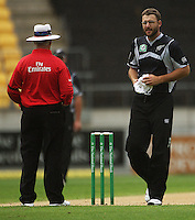 NZ captain Daniel Vettori dries the ball as he walks past umpire Rudi Koertzen during the 2nd ODI cricket match between the New Zealand Black Caps and India at Westpac Stadium, Wellington, New Zealand on Friday, 6 March 2009. Photo: Dave Lintott / lintottphoto.co.nz