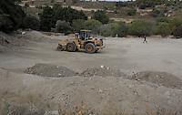 Pictured: Piles of soil, some already examined, some waiting to be sifter at the farmhouse site, where Ben Needham disappeared from in Kos, Greece. Wednesday 12 October 2016<br />Re: Police teams led by South Yorkshire Police are searching for missing toddler Ben Needham on the Greek island of Kos.<br />Ben, from Sheffield, was 21 months old when he disappeared on 24 July 1991 during a family holiday.<br />Digging has begun at a new site after a fresh line of inquiry suggested he could have been crushed by a digger.