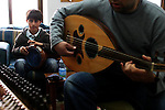 "FOR FAOIROUZ SONG ""THE FLOWER OF THE CITIES"" - A Palestinian boy plays the Darbuka  and his teacher the Oud during a lesson in the Edward Said National Conservatory of Music in East Jerusalem. Photo by Quique Kierszenbaum."