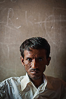 Mr Radheshyam Jigujar, 27 poses for a photograph in the Dardaturki village in the Tonk District of the Northern Indian state of Rajasthan on the 5th of April 2011.