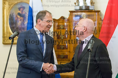 Sergei Lavrov (L) Foreign Minister of Russia shakes hands with his Hungarian counterpart Janos Martonyi (R) after a press conference in Budapest, Hungary on May 02, 2013. ATTILA VOLGYI