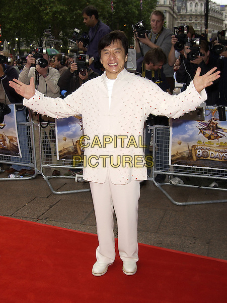 "JACKIE CHAN.arrivals at premiere of.""Around the World in 80 Days"".Leicester Square, London.22 June 2004.CAP/PL.full length, white suit, spots, dots, circles, buttons, asian style jacket.www.capitalpictures.com.sales@capitalpictures.com.©Capital Pictures"