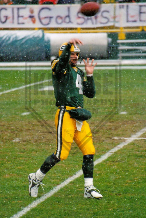 GREEN BAY - DECEMBER 1998: Brett Favre (4) of the Green Bay Packers warms up prior to a game on December 20, 1998 at Lambeau Field in Green Bay, Wisconsin. (Photo by Brad Krause)