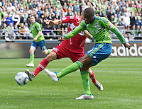 Seattle Sounders FC forward Steve Zakuani takes a shot of goal against Chicago Fire midfielder Chicago Fire12\ during play at Qwest Field in Seattle Tuesday April 8, 2011. The Sounders won the game 2-1.