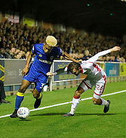 AFC Wimbledon's Lyle Taylor fends off Milton Keynes' Alex Gilbey during the Sky Bet League 1 match between AFC Wimbledon and MK Dons at the Cherry Red Records Stadium, Kingston, England on 22 September 2017. Photo by Carlton Myrie / PRiME Media Images.