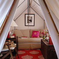 View into the logger's tent that has been erected in the apartment to create a cosy study