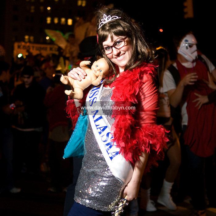 A parade-goer dressed as Republican vice-presidential candidate and Alaska governor Sarah Palin poses for the photograph during New York's Village Halloween Parade on Sixth Avenue in New York City, USA, 31 October 2008.