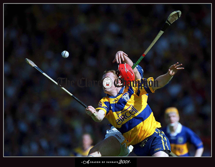 ÒWhatever up we got from Johnny coming on, well we lost it fairly quickly,Ó said Nicky English. Hardly anybody in Tipperary hurling is as beloved as Johnny Leahy. With the game hanging on a thread in P‡irc U' Chaoimh, Nicky English plays his talisman. As Leahy joins the fray the stadium erupts. There is a sense of drama about everything he does. His entry says something. Game on. ClareÕs own rain-maker is Brian Lohan. The thought of the two men clashing with the game going to the death is what makes hurling great. Sixty seconds of thunder. Then Johnny Leahy bursts for this ball, arriving behind Lohan. He falls awkwardly and rips his cruciate ligament. Show over Ñ but the residue of his inspirational arrival will sustain his comrades....... From A Season of Sundays 2001, A pictorial record of the Gaelic Games year with captions by Tom Humphries, The Irish Times. No Reproduction Fee when used in conjunction with a review of the book. Issued by SPORTSFILE