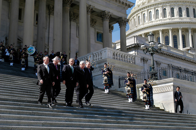Ireland's Foreign Minister Dermot Ahern, Prime Minister Bertie Ahern, President George W. Bush, Speaker of the House Dennis Hastert, R-Il., and Peter Hain, British Secretary of State to Northern Ireland leave the annual St. Patrick's Day luncheon at the Capitol.