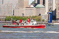 Spectators on Fireboat.org John J. Harvey watch Artemis Team Sweden race on the Hudson River in the Louis Vuitton America's Cup.