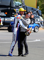 Jul. 28, 2013; Sonoma, CA, USA: NHRA pro stock motorcycle rider Hector Arana Jr celebrates with girlfriend Nicole Nobile after winning the Sonoma Nationals at Sonoma Raceway. Mandatory Credit: Mark J. Rebilas-