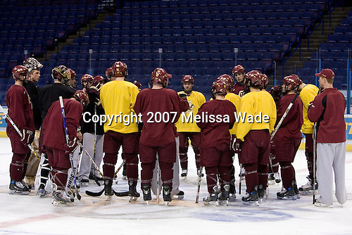 BC players gather at center ice around Coach York during Boston College Eagles' morning skate on Thursday, April 5, 2007, at the Scottrade Center in St. Louis, Missouri.